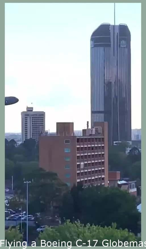 Flying a Boeing C-17 Globemaster through the middle of a city in Australia.