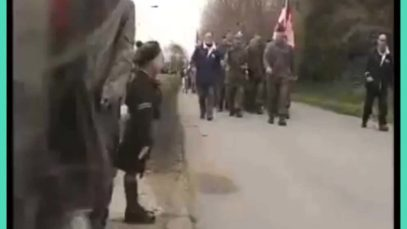 """A lone young Belgian boy saluting the Canadians after waiting more than a minute (in source). He is rewarded with an """"Eyes right"""" from the Canadian CO"""