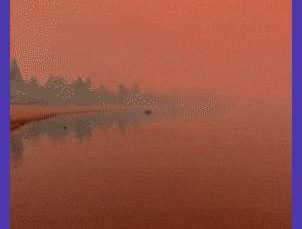 Lake Tahoe, California, with red skies as a result of the Caldor Fire